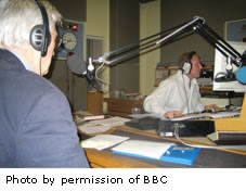 A picture of Patrick Tansey in a radio station studio on air
